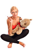 Beautiful young blonde girl with plush bear Stock Images