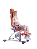 Blonde young woman on exerciser Royalty Free Stock Image