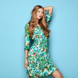 Blonde young woman in floral spring summer dress stock images