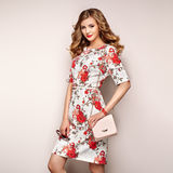 Blonde young woman in floral spring summer dress Stock Photos