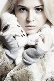 Blonde young woman in fur coat Stock Photo
