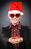 Blonde young woman gives gift Royalty Free Stock Photo