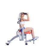 Blonde young woman on isodynamic exerciser Stock Photo