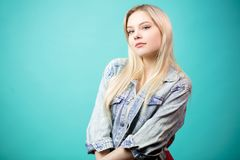 Blonde young woman isolated over blue background. royalty free stock photos