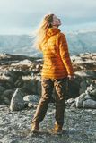 Blonde young Woman outdoor in mountains. Relaxing Travel healthy Lifestyle concept harmony with nature Stock Image