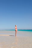 Blonde young woman paradise beach Royalty Free Stock Image