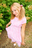 Blonde young woman in pink dress Stock Photo