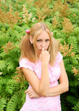 Blonde young woman in pink dress Royalty Free Stock Photography