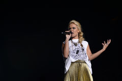 Blonde Young Woman Singer, TV Show, Live Concert Stock Photo