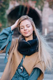 Blonde young woman smiling laughing fashion emotional Royalty Free Stock Photo