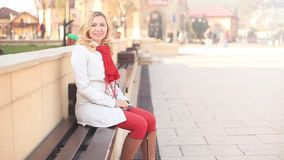Blonde young woman in urban environment stock footage