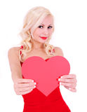 Blonde young woman with Valentine heart, isolated Royalty Free Stock Photos