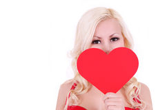 Blonde young woman with Valentine heart, isolated Royalty Free Stock Image