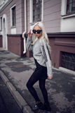 Blonde young woman walking outside Royalty Free Stock Images