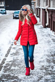 Blonde young woman walking outside Royalty Free Stock Photo