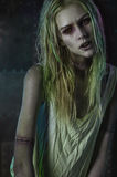 Blonde zombie woman on dark background Royalty Free Stock Photos