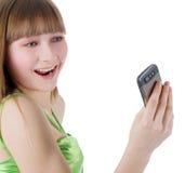 Blondemeisje met cellphone op wit Royalty-vrije Stock Foto