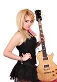 Blondemeisje met het elektrische gitaar stellen stock afbeeldingen