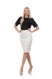 Blondemeisje in zwarte die rok op wit wordt geïsoleerd Royalty-vrije Stock Afbeeldingen