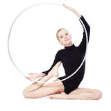 Blonder Gymnast mit hula Band Stockfoto