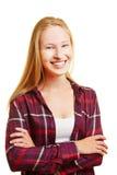 Blonder Jugendlicher mit ihren Armen gekreuzt Stockbild