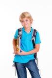 Blonder Junge mit Schultasche und Büchern Lizenzfreie Stockfotografie