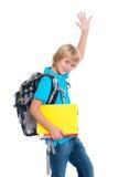 Blonder Junge mit Schultasche und Heft Stockfotos