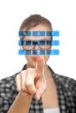 Blonder Kursteilnehmer Mädchen rührende Zahl 2 auf einem Tastaturblock Lizenzfreie Stockbilder