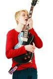 Mann, der E-Gitarre leckt Lizenzfreies Stockfoto
