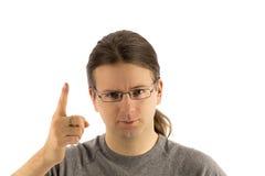 Blonder Mann mit einem verärgerten Blick Stockbilder