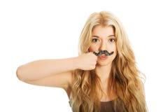 Blonder Student mit dem Schnurrbart Stockbild
