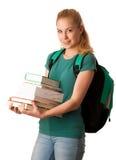 Blonder Student mit dem Stapel von Büchern und von Rucksack, glücklich, kn zu erhalten Lizenzfreie Stockfotografie