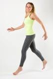 Blondes athletisches Frauenlaufen elegant Stockfotos