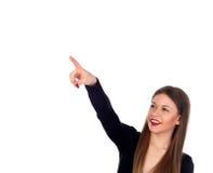 Blondes attraktives Mädchen, das etwas mit ihrem Finger anzeigt Stockfotos