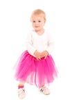 Blondes Baby im rosa Ballettröckchen und in den Turnschuhen Lizenzfreies Stockbild