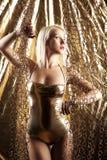 Blondes Baumuster im Gold Stockfotos