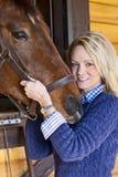 Blondes Baumuster mit Pferden Stockbild