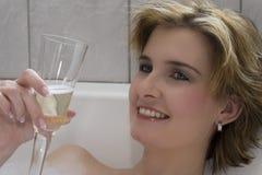 Blondes Champagnerlächeln Lizenzfreies Stockfoto