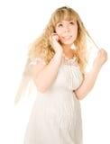 Blondes Engelsmädchen mit Telefon Lizenzfreies Stockbild