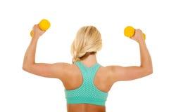 Blondes Fraueneignungs-BHblau-Rückseitenflex Stockbilder