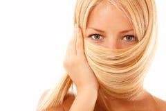 Blondes Haar des jugendlich Mädchens lokalisiert auf Weiß Stockfotografie