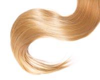 Blondes Haar lokalisiert auf Weiß Stockfotos