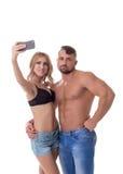Blondes Handelnselfie und ihr Freund gebohrt Lizenzfreies Stockfoto