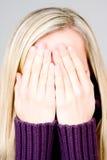 Blondes Jugendlichbedeckunggesicht Stockfoto