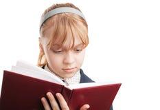 Blondes kaukasisches Schulmädchen mit Buch Lizenzfreies Stockfoto