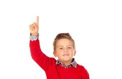 Blondes Kind mit dem roten Trikotbitten Lizenzfreies Stockbild