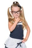 Blondes kleines Mädchen denkt Stockfoto