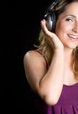 Blondes Kopfhörer-Mädchen Stockfotos