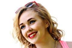 Blondes Mädchen auf einem weißen Hintergrund Lizenzfreie Stockbilder