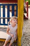Blondes Mädchen auf Spielplatz Stockbilder